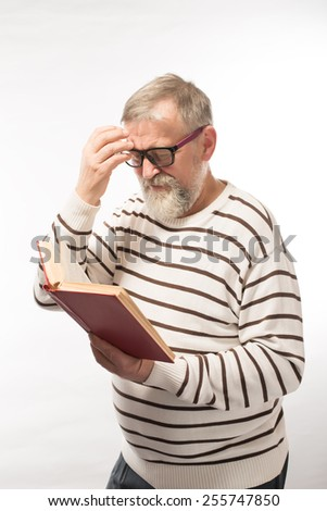 Grandpa reading red book on a white background, emotions - stock photo