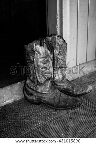 Grandpa's cowboy boots - stock photo