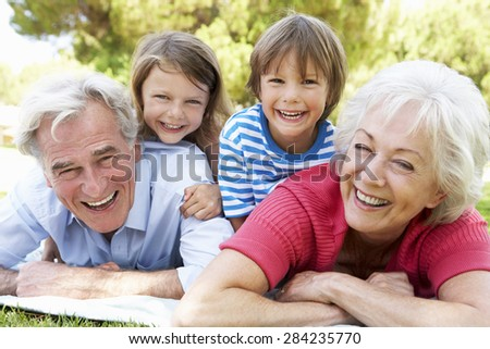 Grandparents And Grandchildren In Park Together - stock photo