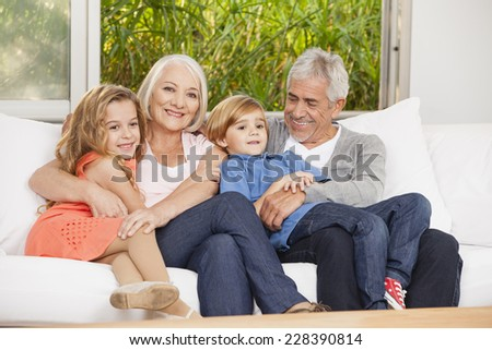 Grandparents and grandchildren on couch