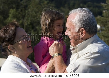 Grandparents and granddaughter