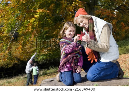 Grandparents and grandkids exploring in woods