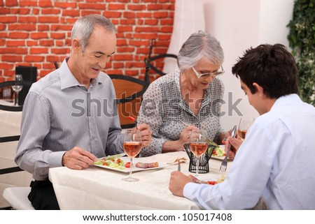 Grandparents and grandson at restaurant