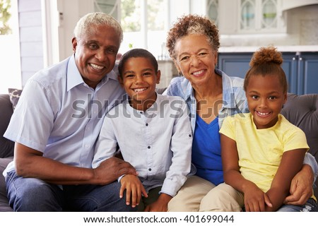 Grandparents and their young grandchildren at home, portrait - stock photo