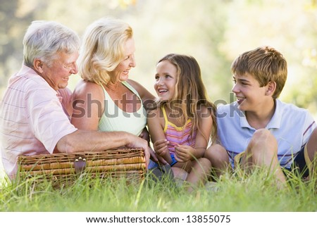 Grandparents having a picnic with grandchildren - stock photo