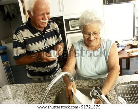 grandparents in a kitchen - stock photo