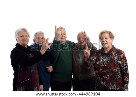 grandparents making the sign of victory - stock photo