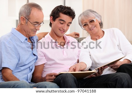grandparents spending time with their grandson - stock photo
