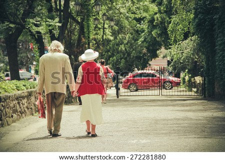 Grandparents walking summer day - stock photo