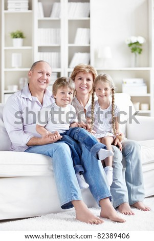 Grandparents with grandchildren at home - stock photo