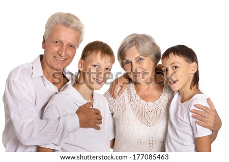 Grandparents with grandkids on white background