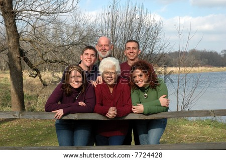 grandparents with grandkids outdoors - stock photo