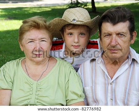 Grandparents with grandson - stock photo