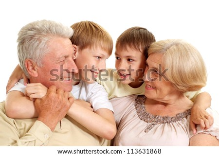 Grandparents with their sweet  grandchildren on a white background - stock photo
