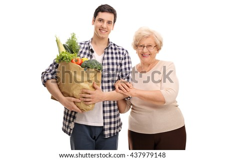 Grandson helping his grandmother with the groceries isolated on white background - stock photo