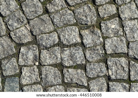 granite block pavement of the old street - stock photo
