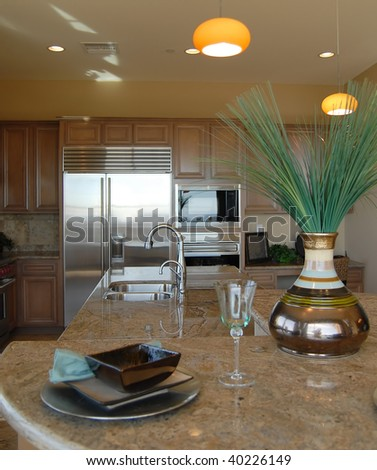 Granite counter top in large beautiful kitchen - stock photo
