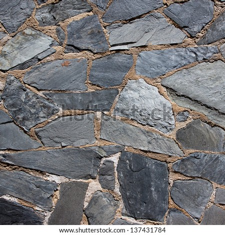 Granite gray flagstone pavement wall background - stock photo