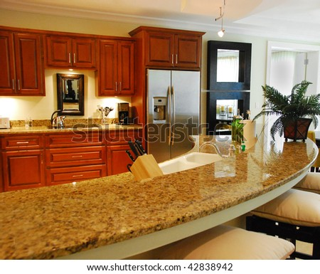 Granite Kitchen Counter with Cabinets in Background - stock photo