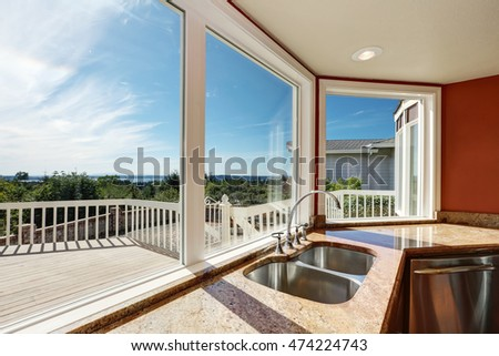 Granite Kitchen counter with double sink and perfect window view. Interior design. Northwest, USA