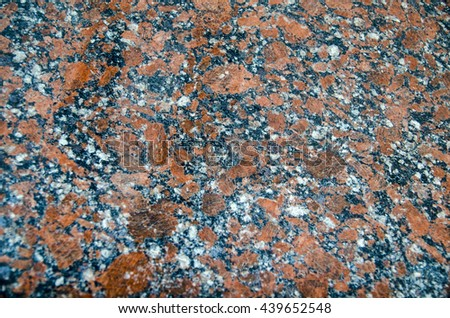 Granite rock pattern close view, natural texture background - stock photo