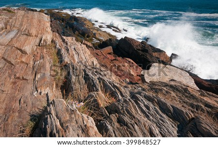Granite rocks and crashing waves on Maine coast as hurricane hit coastal states farther south in USA