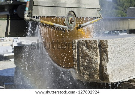granite sawing machine in a factory from a quarry - stock photo