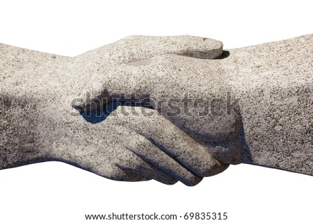 Granite sculpture of shaking hands isolated on white background. - stock photo
