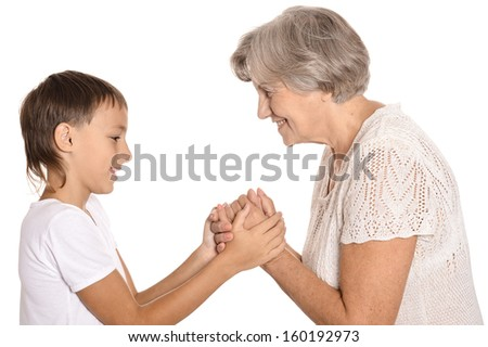 Granny and grandson holding hands on white background
