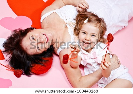 Granny and laughing little girl - stock photo
