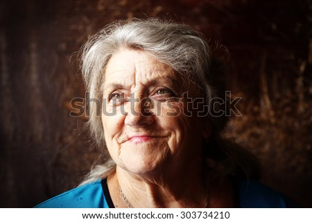 Granny face on a dark background - stock photo