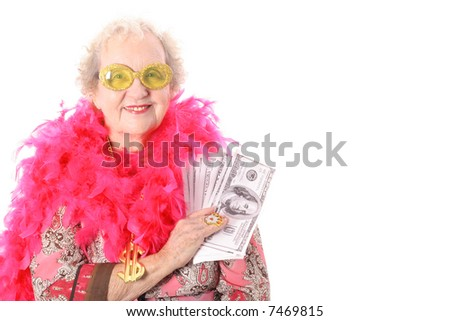 Granny showing off her lottery winnings - stock photo