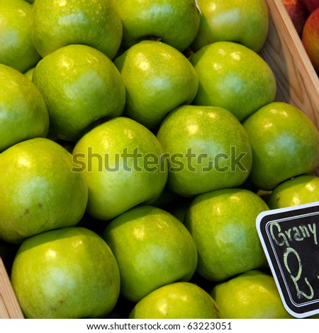 Granny Smith apples in a market stall - stock photo