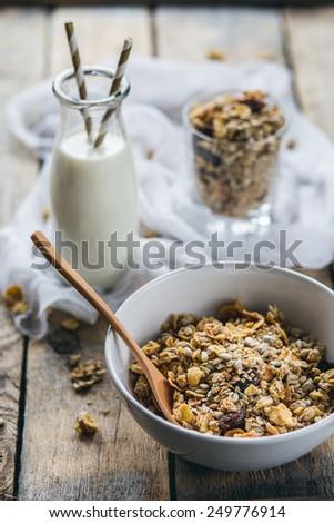 Granola and bottle of milk - stock photo