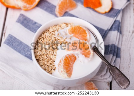 Granola and homemade yogurt with Mandarin.Breakfast is useful. - stock photo