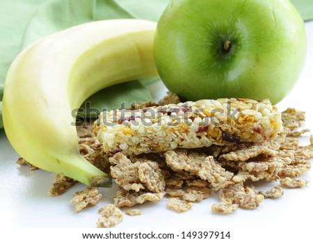 granola bar, green apple and banana - healthy eating - stock photo