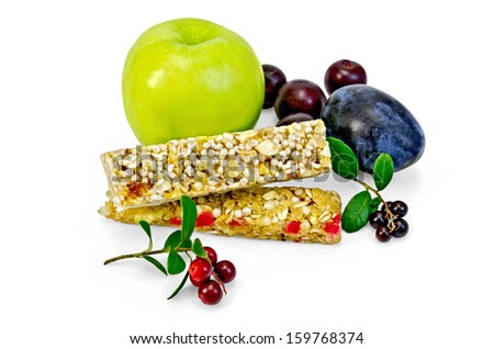 Granola bar, green apple, plum, cherry, branches with leaves and berries lingonberries isolated on white background - stock photo