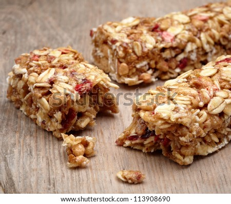 Granola bar on wooden background - stock photo