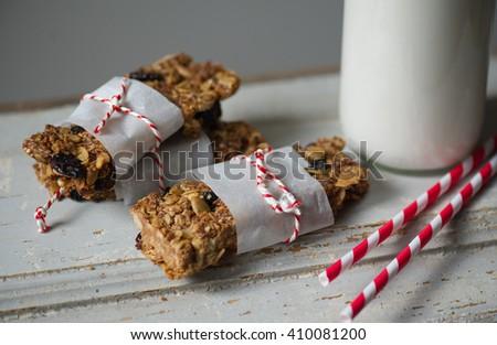 Granola bars and milk - stock photo