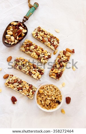 Granola bars / Breakfast bars with granola bowl and a metal scoop overhead view - stock photo
