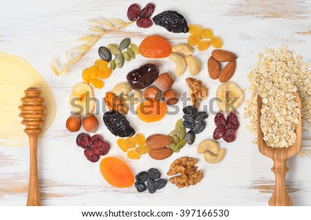 Granola bars ingredients on white wood background, top view. - stock photo