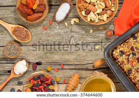 Granola bars ingredients on wood background. Gluten free. Top view. Copyspace background. - stock photo
