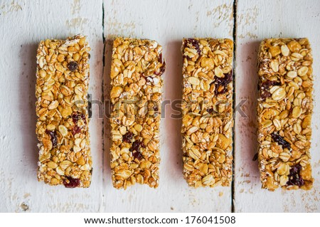 Granola bars on wooden background - stock photo