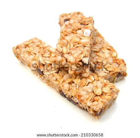 Granola bars with chocolate on white background  - stock photo