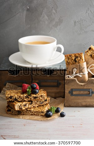 Granola bars with coffee for breakfast to go - stock photo