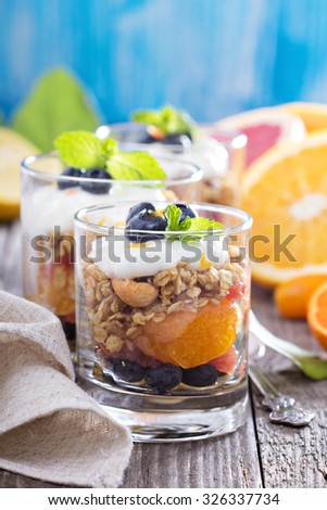 Granola breakfast parfait with citrus compote and blueberries