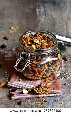 Granola from several types of cereals with nuts,coconut chips and ...
