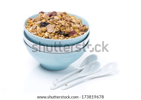 granola in a bowls and spoons, isolated on white background