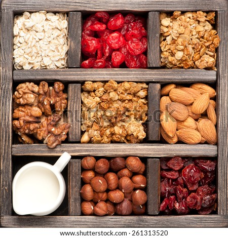 granola, oatmeal, nuts, berries in a wooden box. Top view. Food background - stock photo