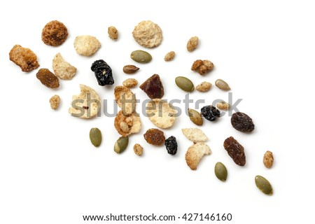 Granola or muesli scattered over white.  Top view. - stock photo